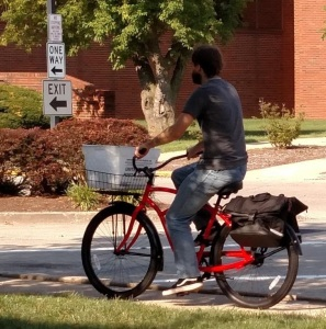Student worker Charles Todd traverses the Belknap campus in style to deliver the dally mail.