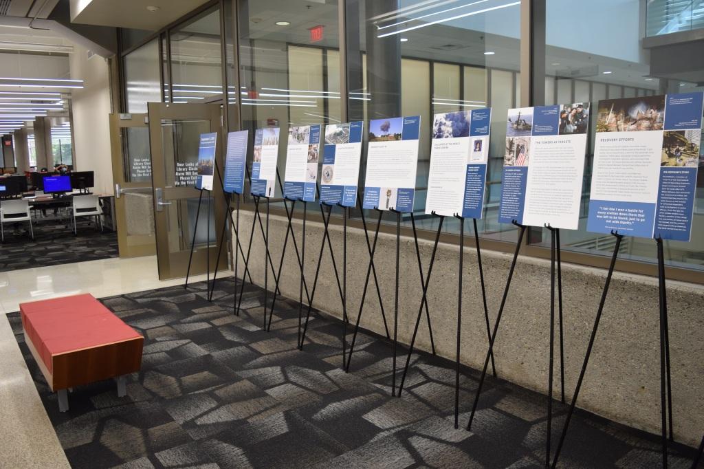 Posters arranged in elevator lobby of Ekstrom library, east side.